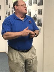 William Lenches, executive director and curator of the 12th Armored Division Memorial Museum in Abilene, speaks Friday to a visiting group of World War II veterans.