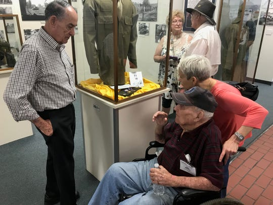 Dale Cartee, left, a volunteer at the 12th Armored Division Memorial Museum, speaks with World War II veteran Robert Kehres and Kathryn Rensner during the 416th Bomb Group's reunion stop at the museum Oct. 5.