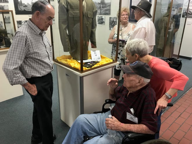 Dale Cartee, left, a volunteer at the 12th Armored Division Memorial Museum, speaks with World War II veteran Robert Kehres, who will turn 103 years old in December, and Kathryn Rensner during the 416th Bomb Group's reunion stop at the museum Friday. Kehres, who served as an engineering officer during the war in England, is one of three remaining members of the group that visited Abilene this week for an annual reunion.