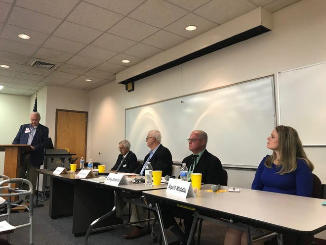 Four of six candidates (from left: Bill Briggs, Norris Gentry, Craig Goforth and April Riddle) for Madison County Board of Commissioners took turns addressing questions during a forum October 1.