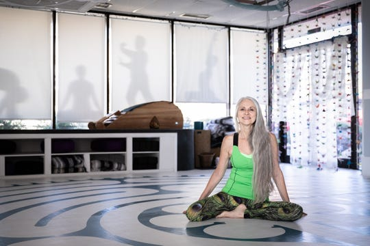 Laura Miklowitz, a breast cancer survivor, at the Shift yoga studio in Hendersonville, Oct. 5, 2018.