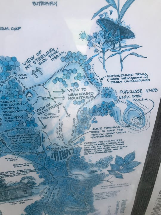 This map at the Education Center near Purchase Knob shows a trail that leads to the knob, but it also notes that the trail is unmaintained and grown in.