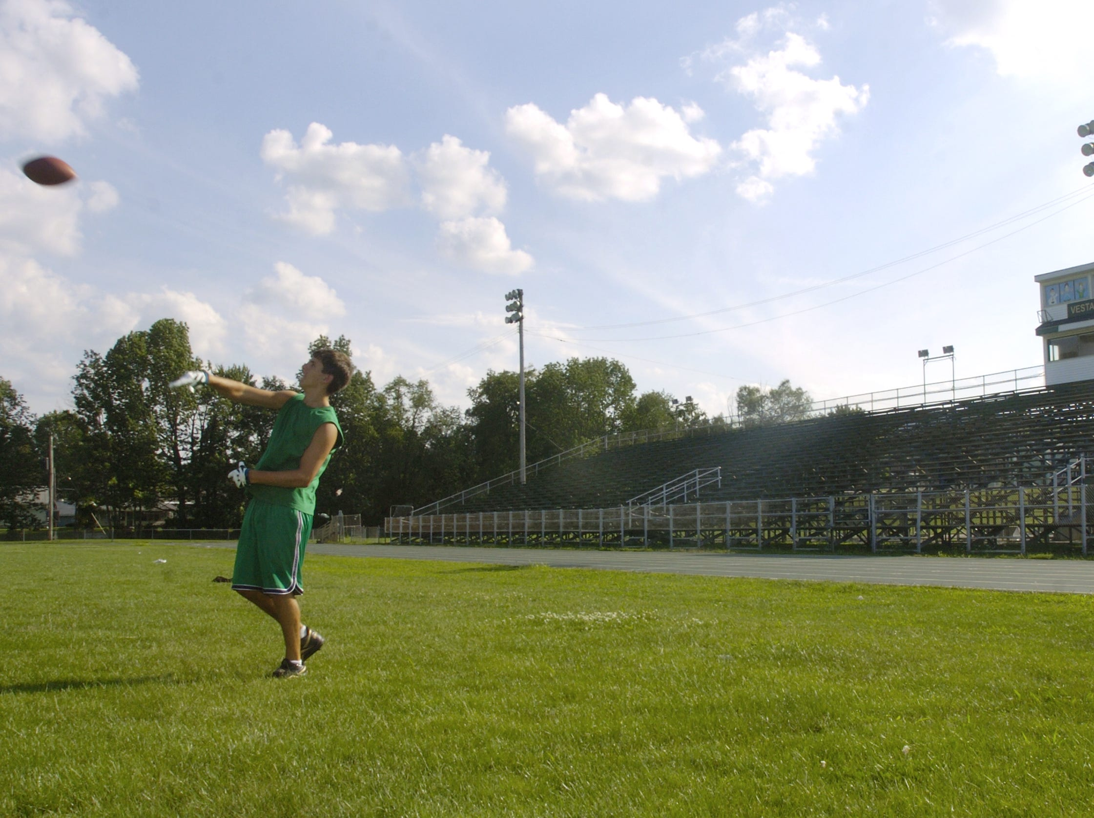In 2004, Vestal High School wide receiver A.J. Davis throws the football during an informal practice session at the school's football field.