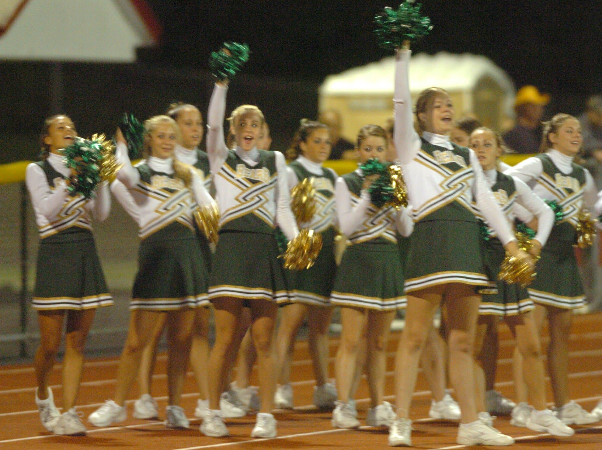 Vestal cheerleaders cheer for their team during Class AA football action on the opening on the 2005 season at Baldwinsville.