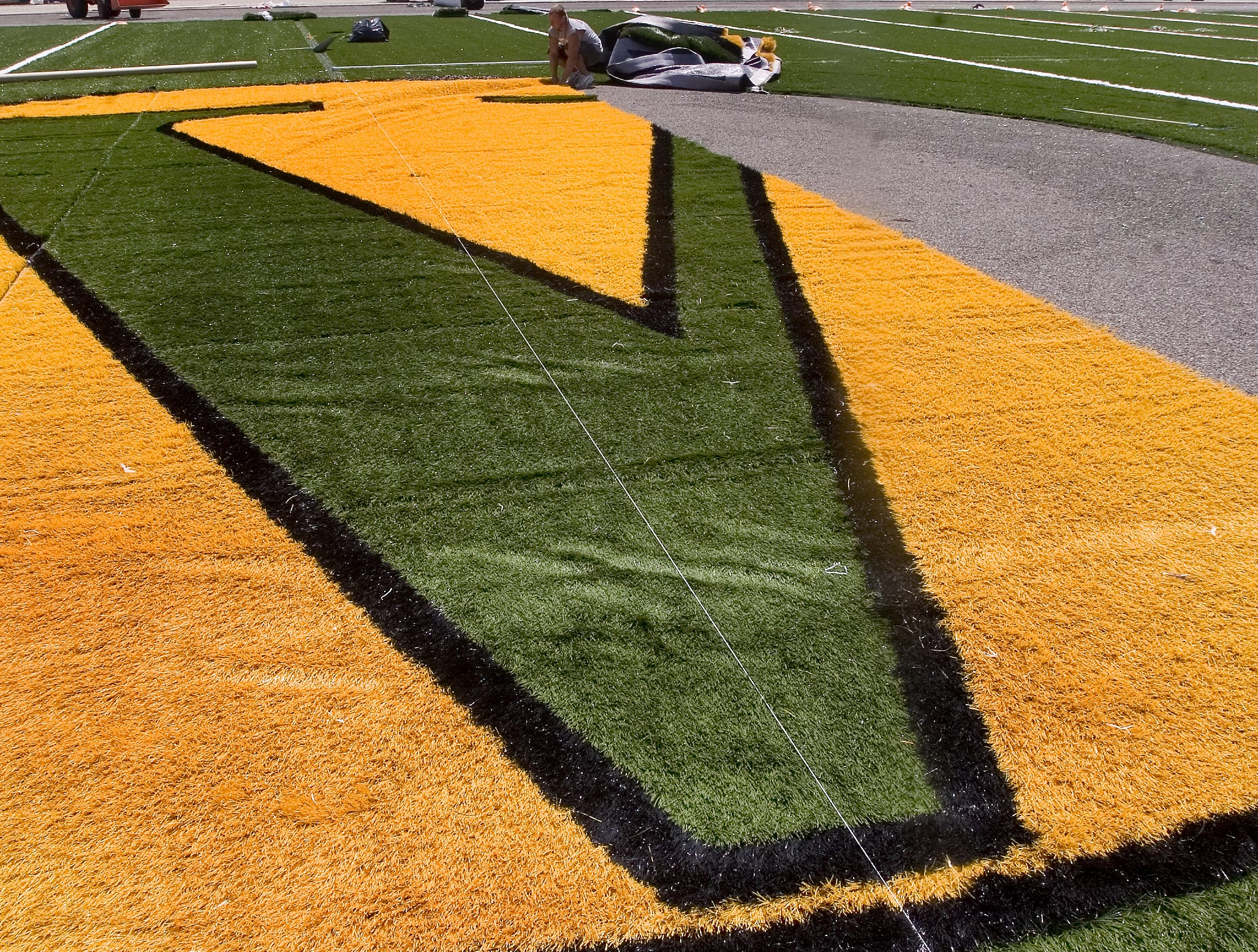 A big V for the school's logo being installed in the center of the synthetic grass field in 2007 at Vestal High School's Dick Hoover Stadium. The complex was undergoing a complete renovation.
