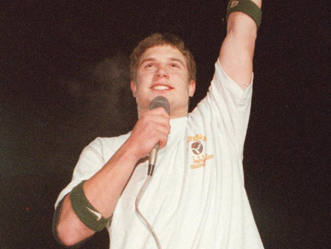 In 1997, Mike Young celebrates Vestal's victory at the welcome home party at Vestal High School stadium.