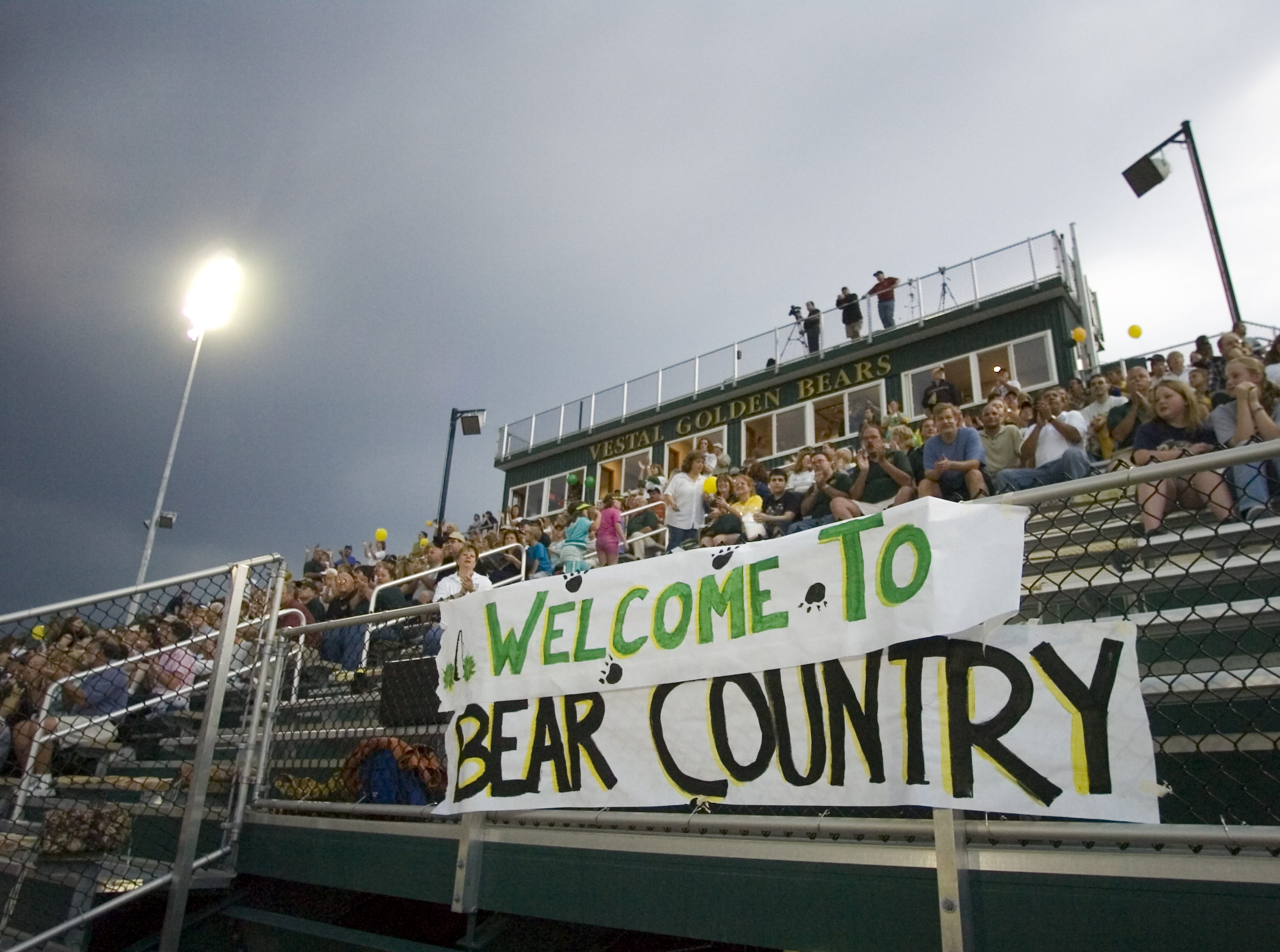 In 2007, Vestal High School football fans watch the first home game of the season in the new stadium against Ithaca.