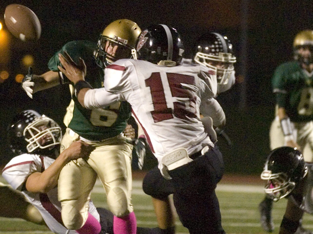 In 2012, Vestal's Marshall Case fumbles as Elmira's Jerry McPeak closes in during the first half.