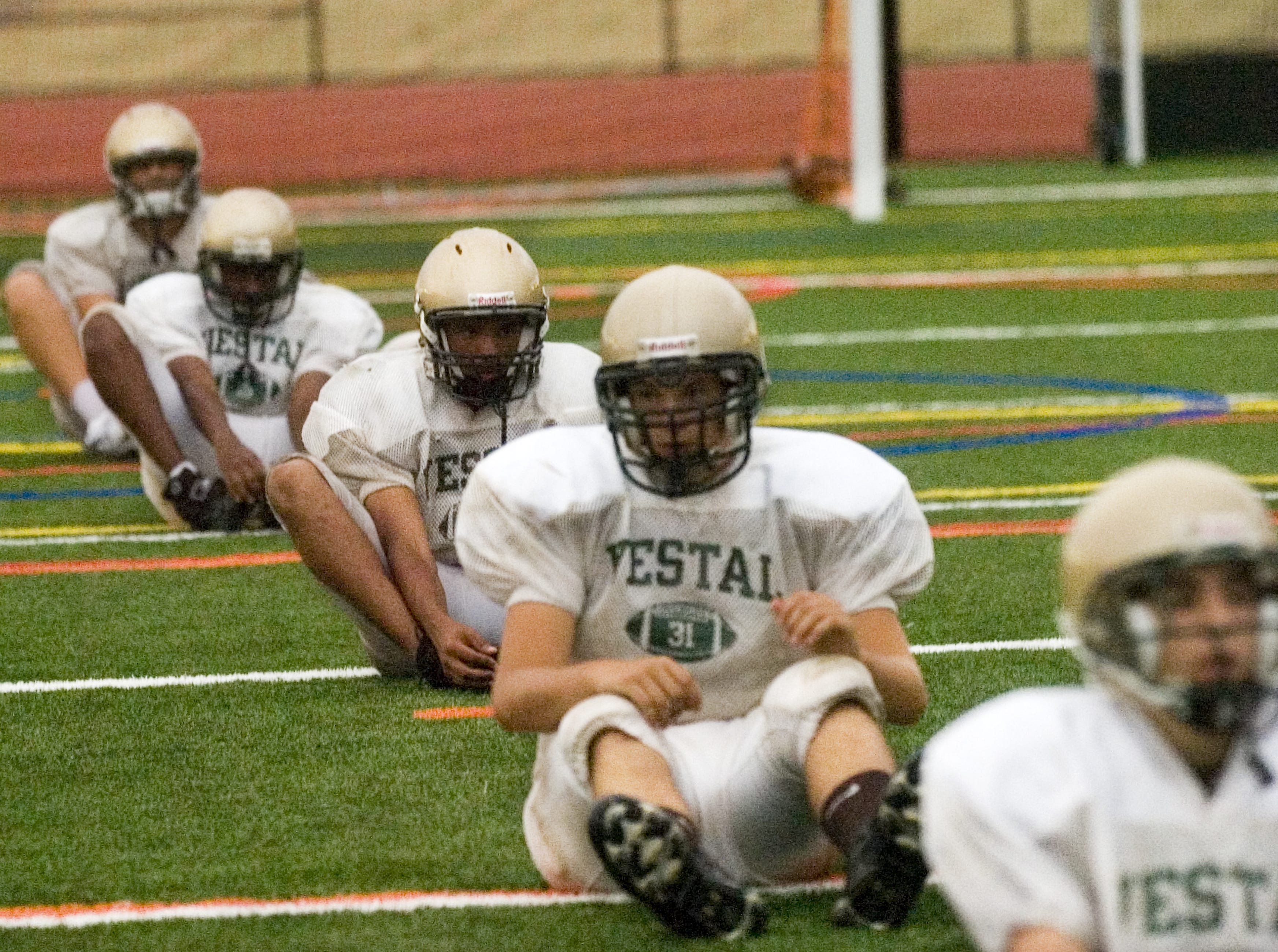 In 2007, Vestal High School varsity football players stretch during their first practice at Dick Hoover Stadium in Vestal.