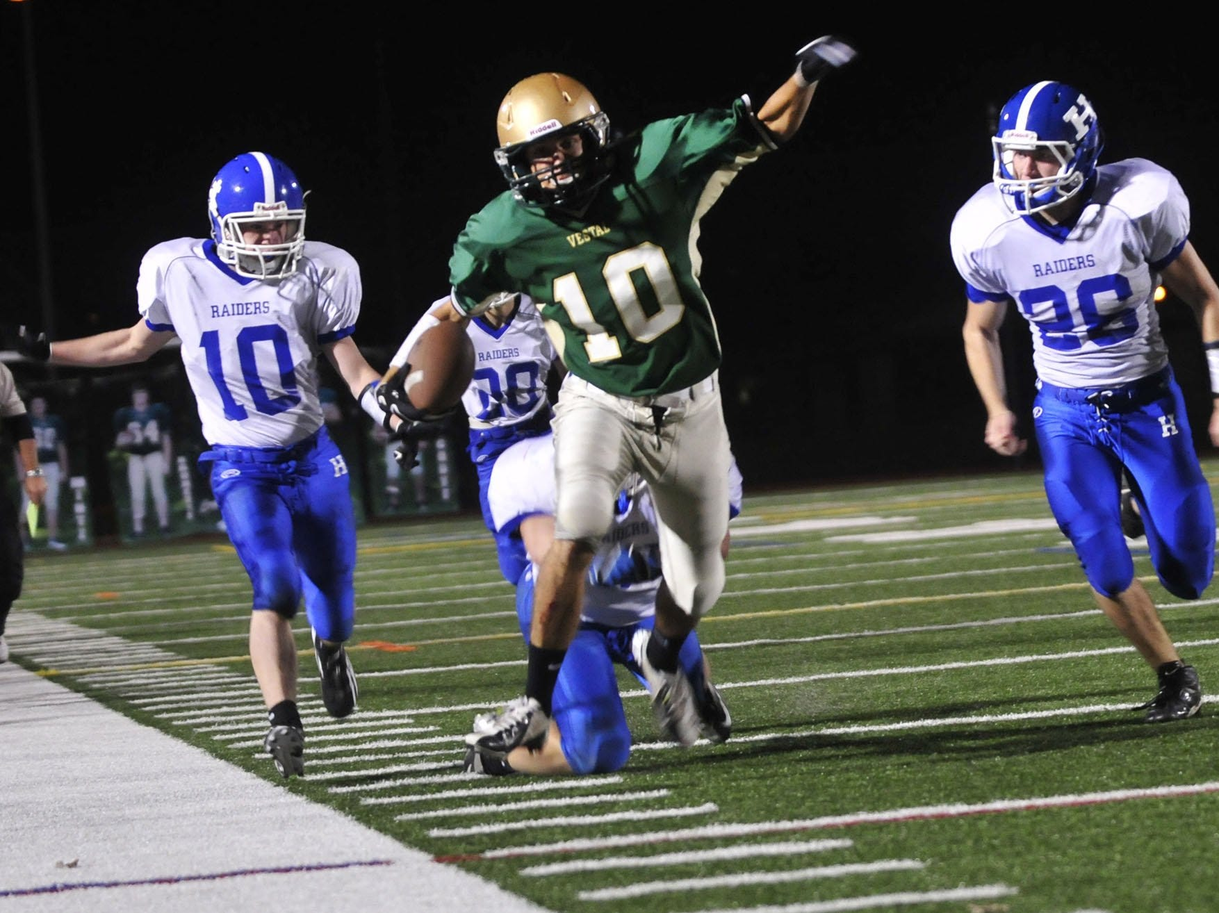 In 2012, Vestal's Mike Chewens runs for a 49-yard touchdown reception during the Section 4 Class A semifinal at Dick Hoover Stadium.
