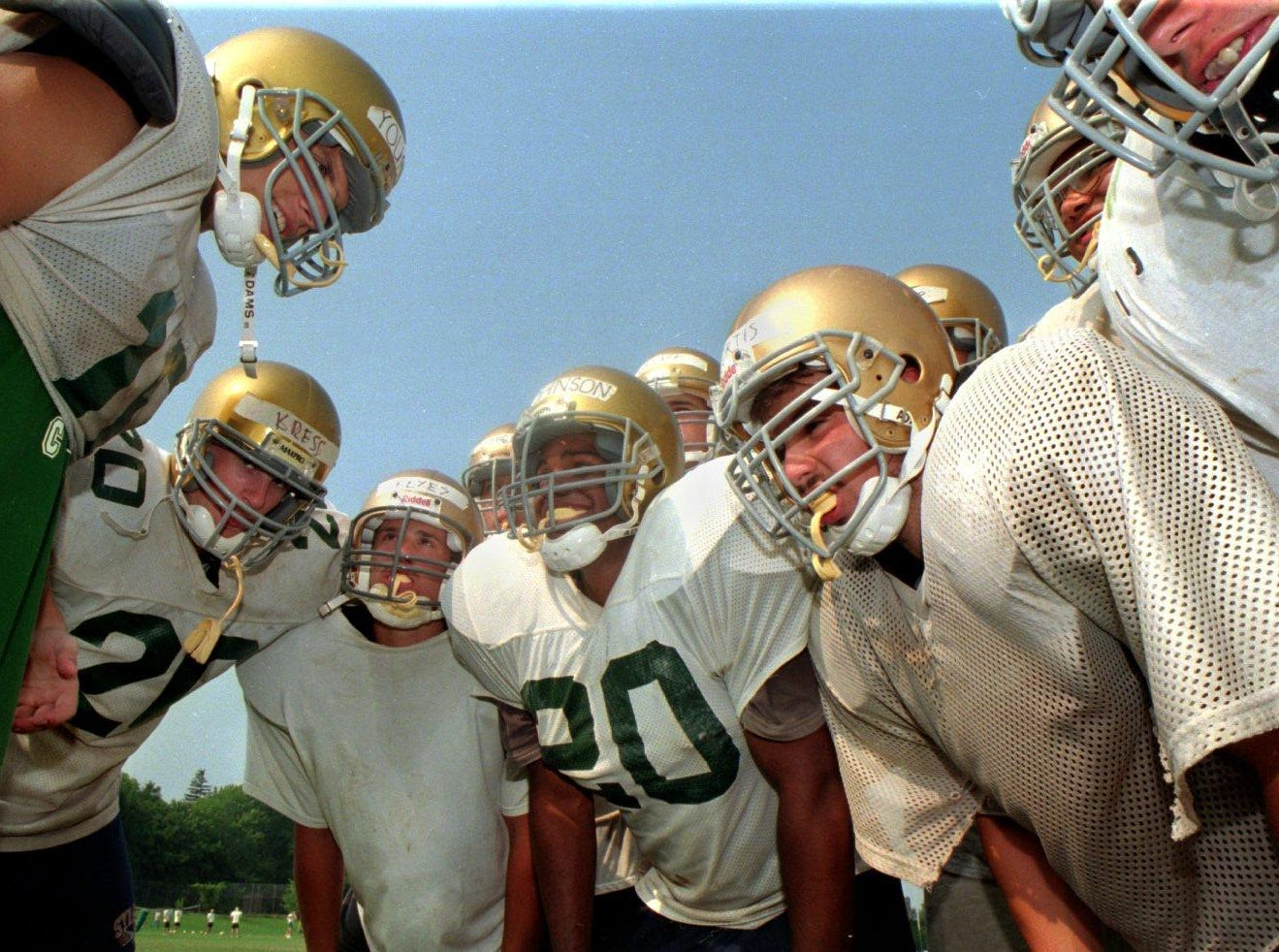 Vestal High School Football players huddle up in 1996