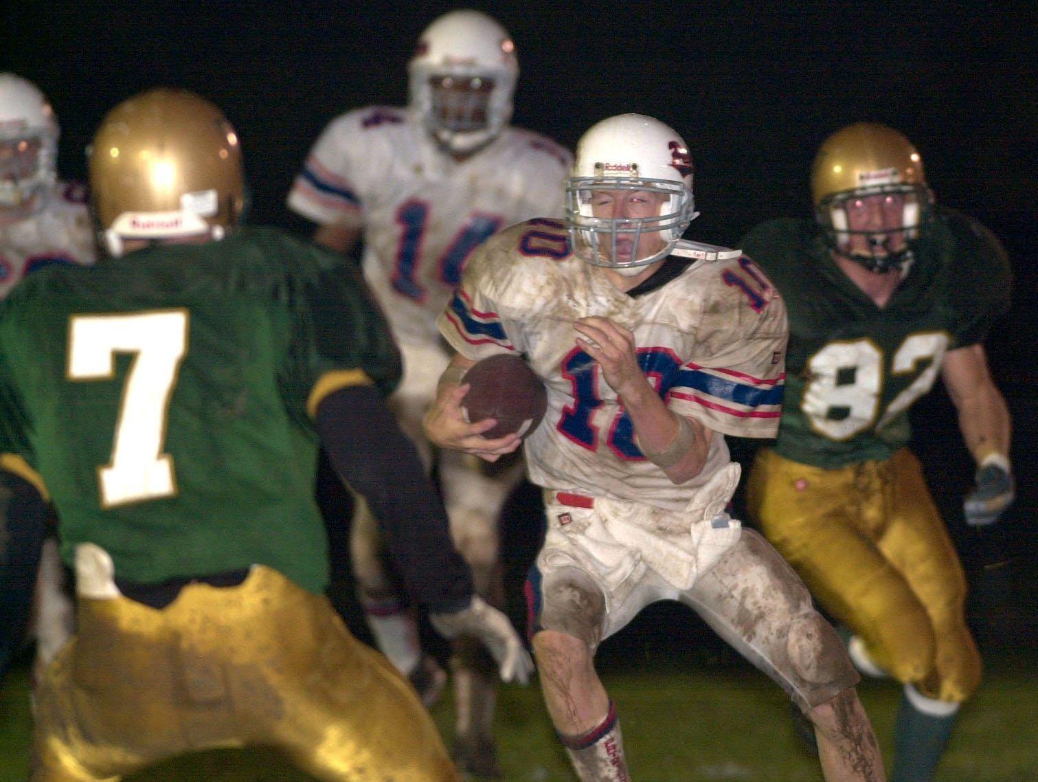 In 2001, Binghamton's quarterback Ryan Connolly gets to the open field as Vestal's Jared Cady looks to stop Connolly as teammate Gary Luciani pursues in the first quarter.