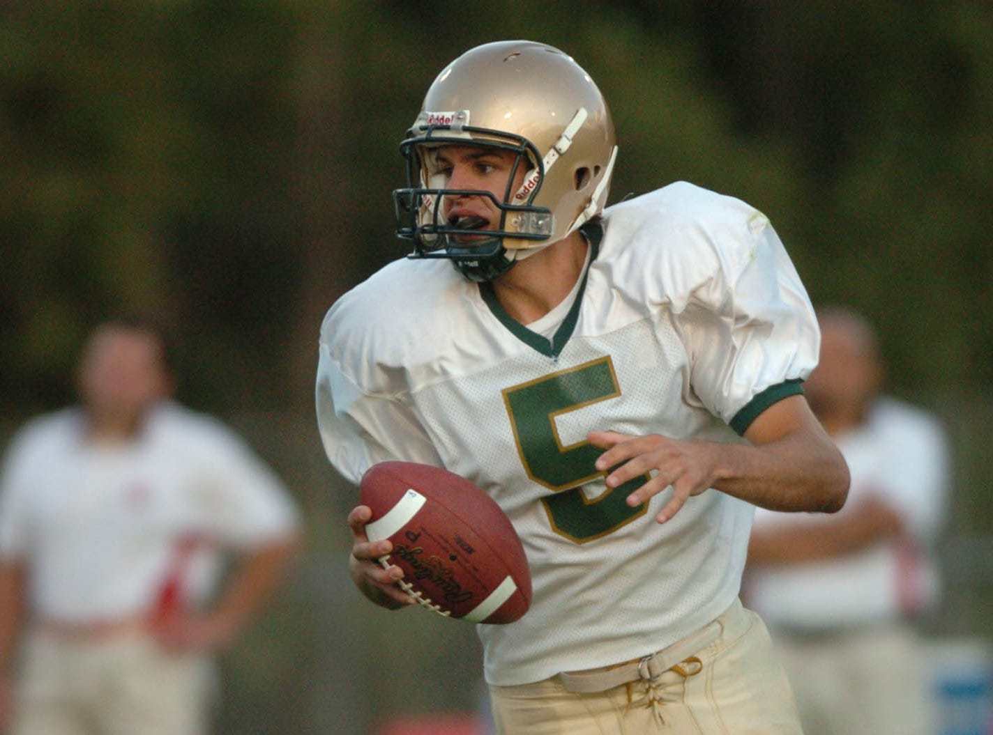 Vestal quarterback Nate Davis looks for a receiver in the first quarter during Class AA football action on the opening on the 2005 season at Baldwinsville.