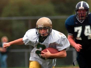 Vestal's Mark Richard carries the ball in the second half against EFA Saturday, Oct. 12, 2001.