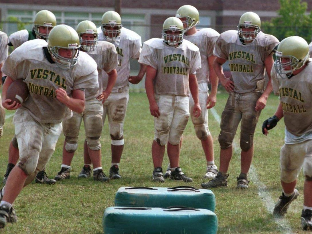 Vestal football players drill during a recent practice for the 1999 High school football preview.