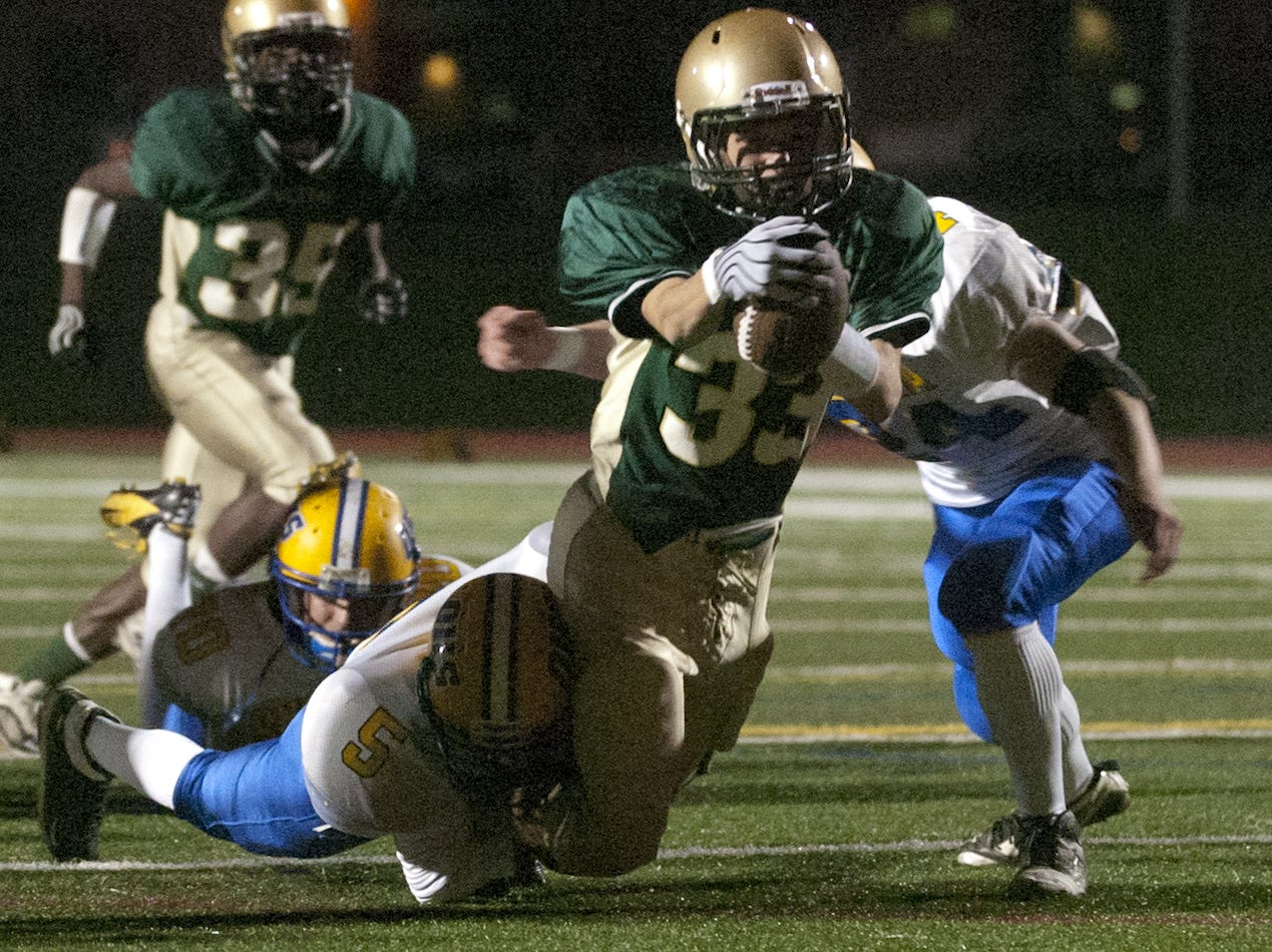 In 2012, Jonathan Vega and Sam Sherrill of Oneonta take down Vestal's Zach Cook at Dick Hoover Stadium in Vestal.