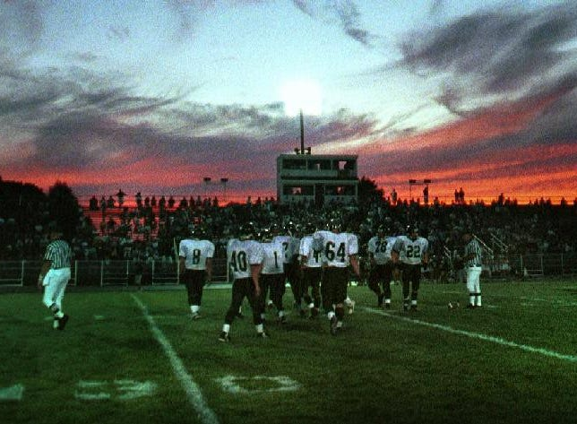 The sun sets over the opening game of the season for the Vestal Golden Bears as they take on Elmira South Side in 1999.