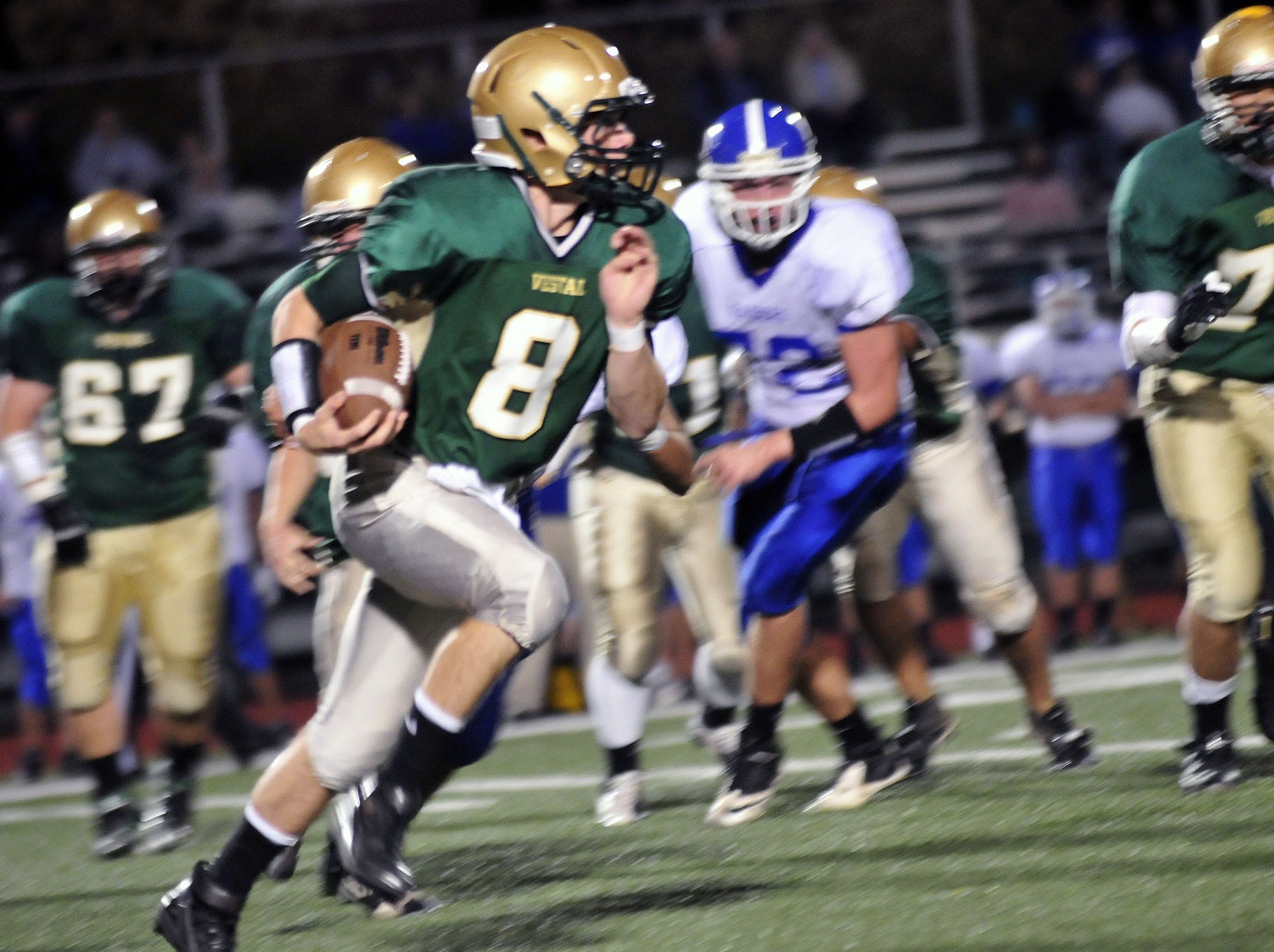 In 2012, Vestal quarterback Nick Wegmann picks up 6 yards against Horseheads.