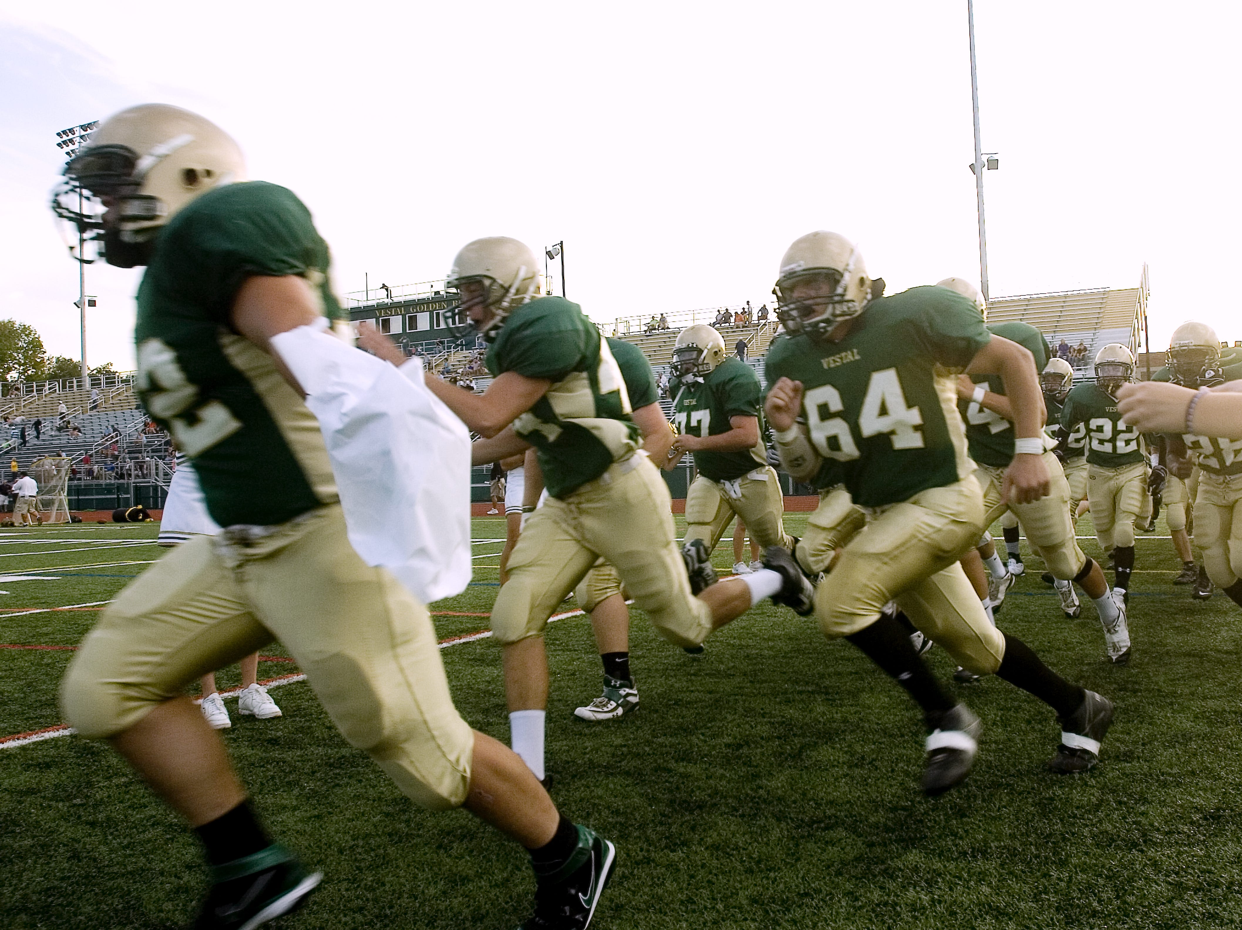 In 2008, the Vestal High School football team takes the field to start the season-opener against Elmira South Side at Dick Hoover Stadium.