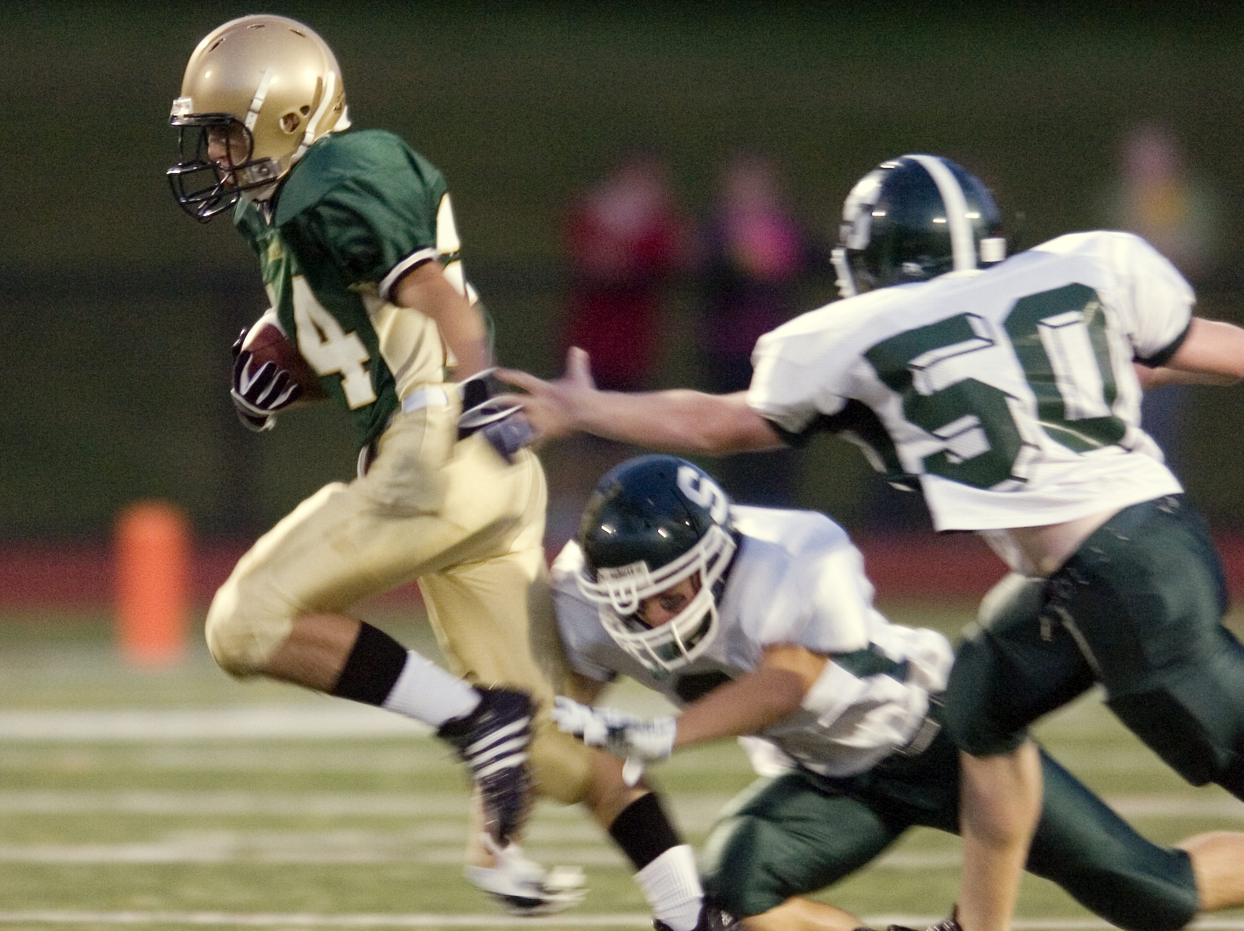 In 2008, Vestal's Tim Vieira, left, returns a kickoff in the second quarter of the  season-opener against Elmira South Side at Dick Hoover Stadium.