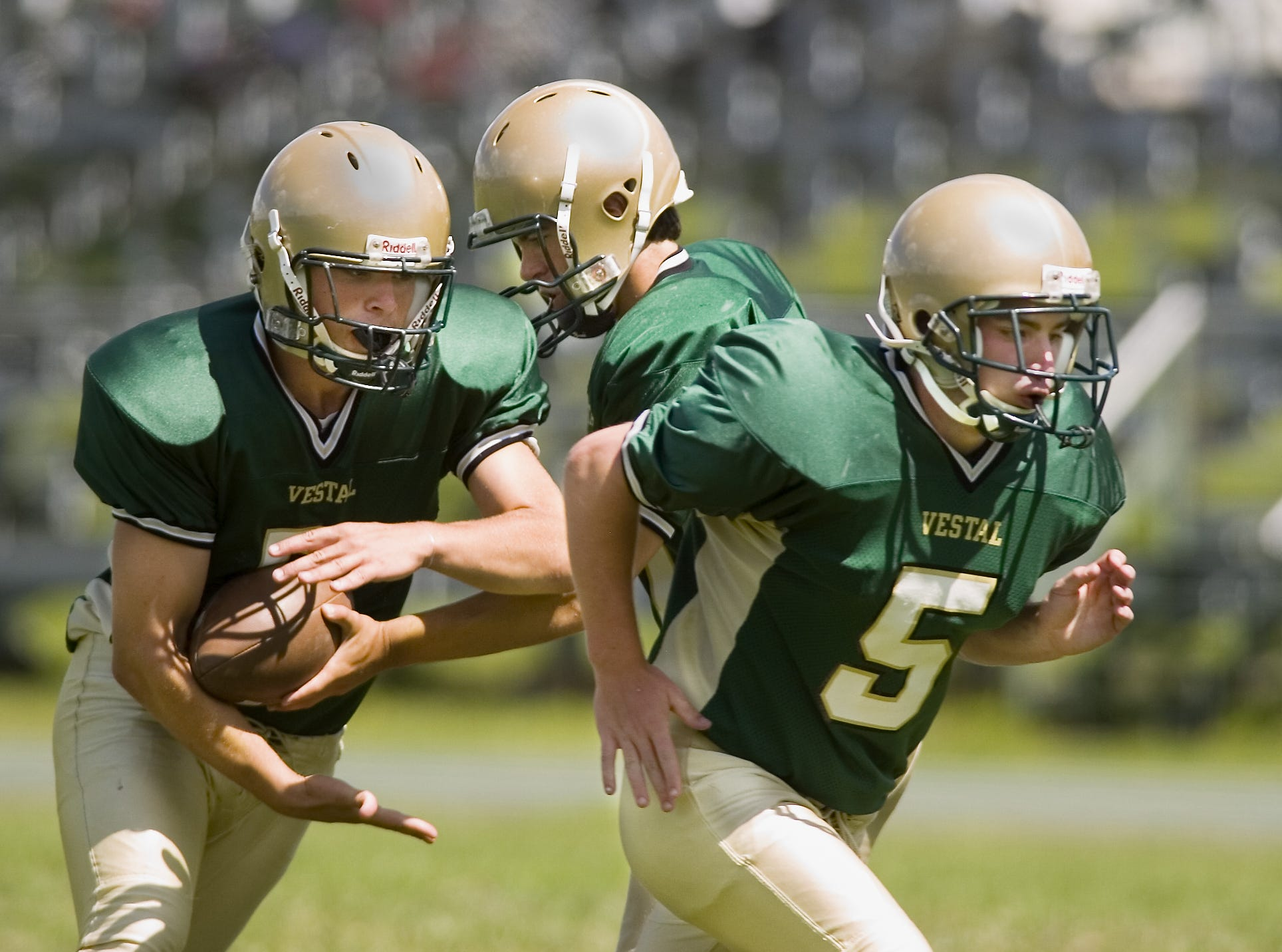 In 2006, Vestal QB Frank Vieira, center, hands off to running back Travis Harrington. At right is running back Pat Zelno.