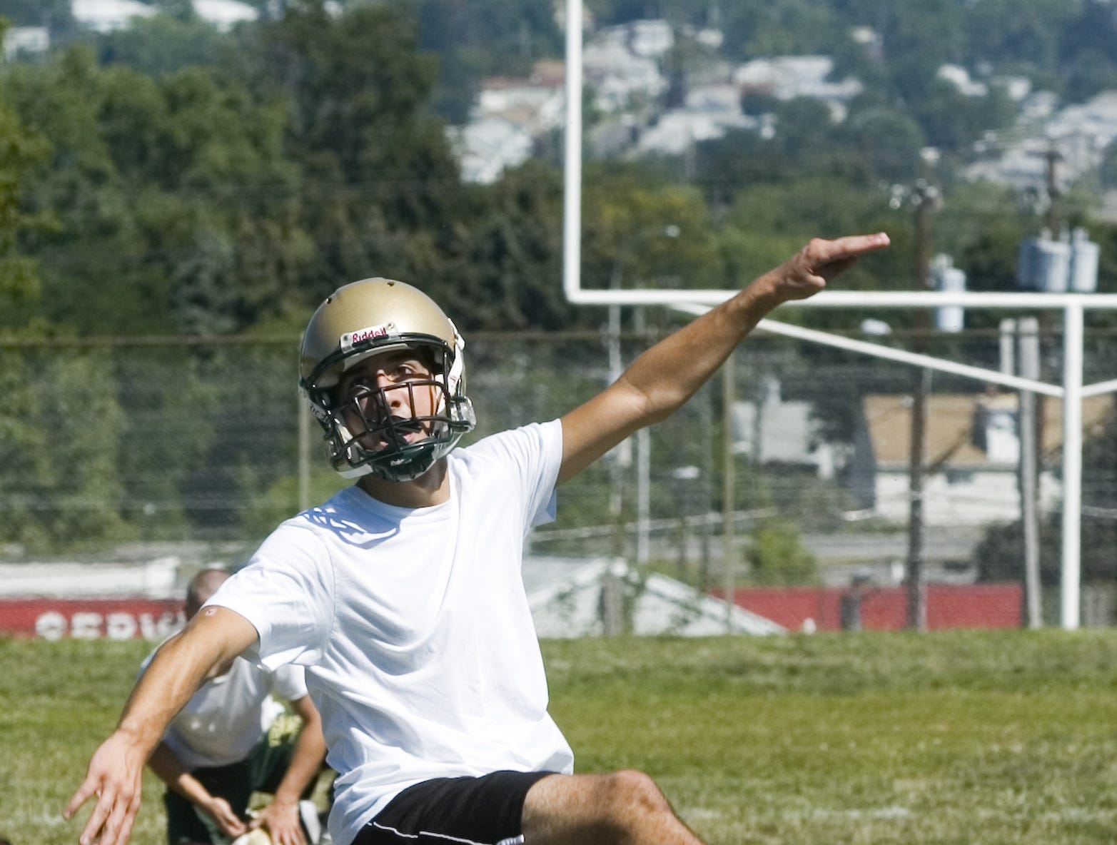 In 2006, Mike Demyan watches his kick sail through the uprights as he practices extra point kicks during the first day of drills at Vestal High School.