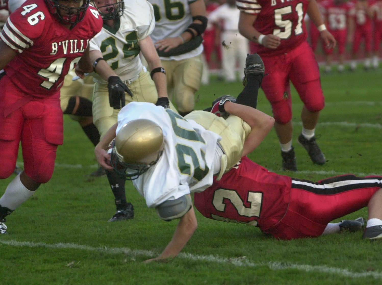 Vestal running back Pat Zelno scores Vestal's first touchdown of the 2005 season over Baldwinsville's Andrew Clark during Class AA football action on the opening night at Baldwinsville.