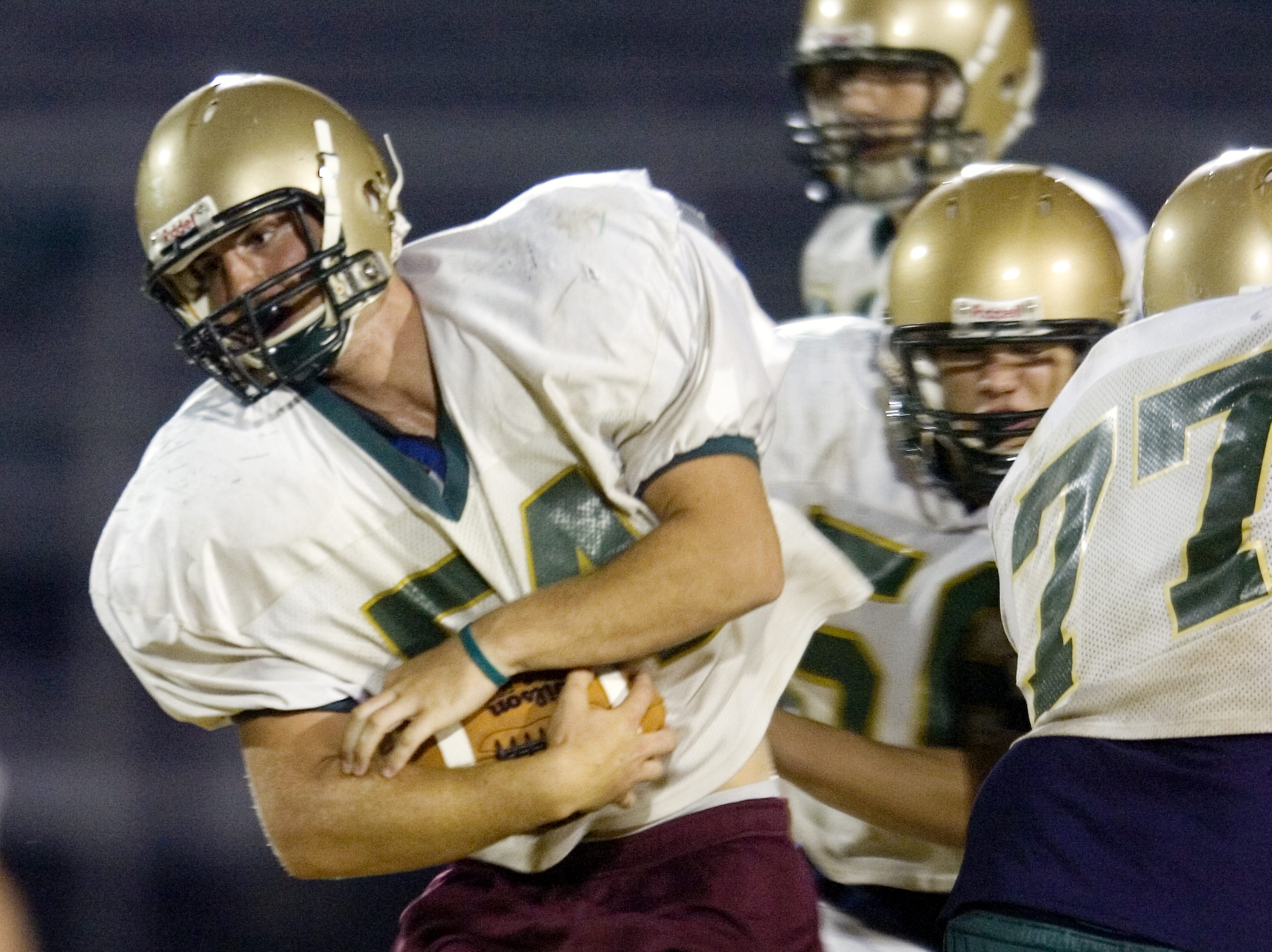 In 2008, Eric Cady runs with the ball during a Vestal High School football team practice at Dick Hoover Stadium.