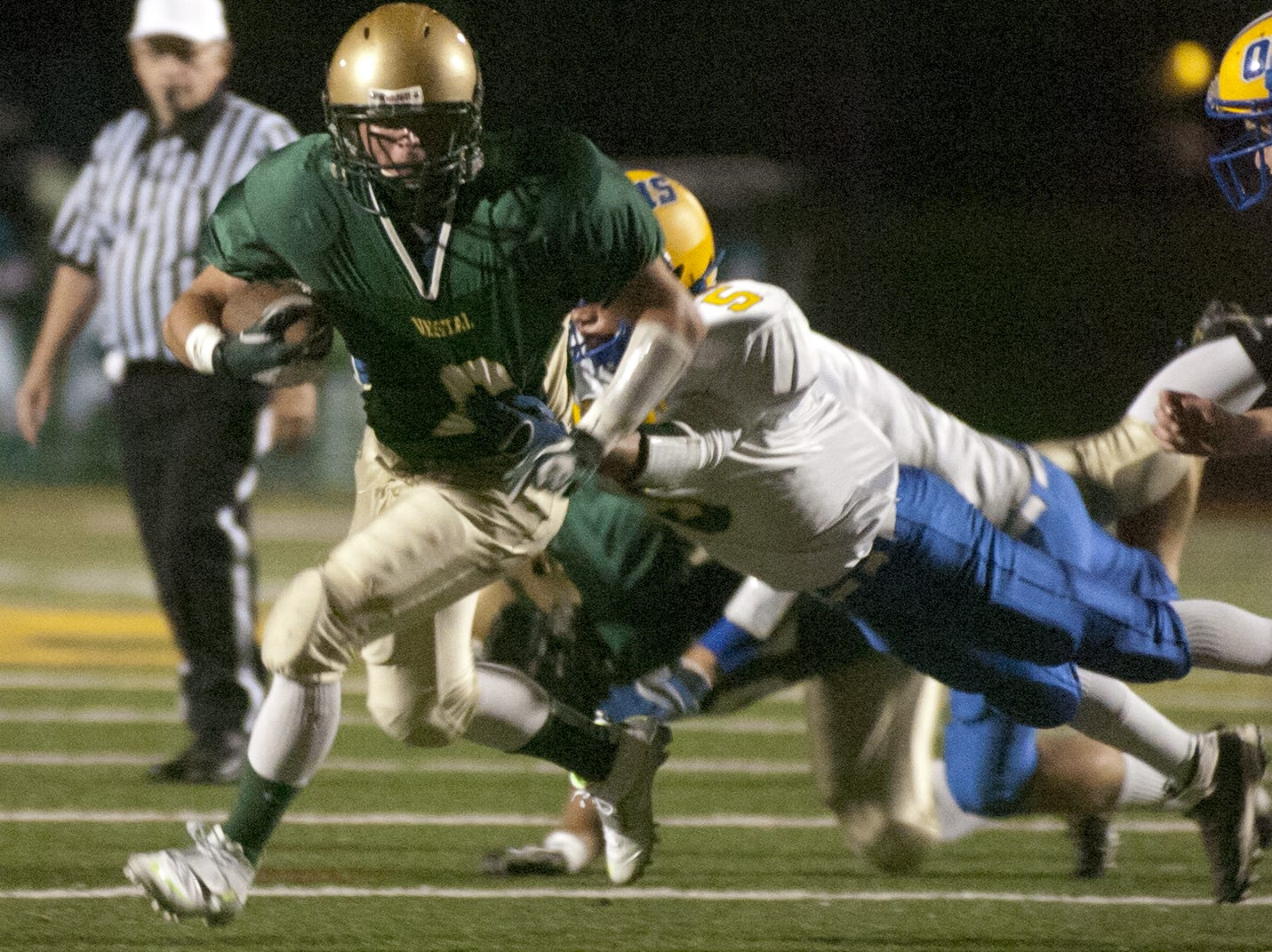 In 2012, Oneonta's Jonathan Vega tries to tackle Vestal's Marshall Case in the first half.
