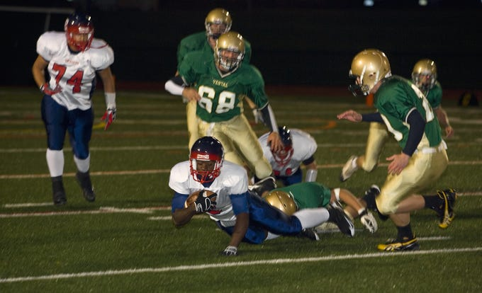 Binghamton's Jamar Smith lunges for extra yards as he is brought down by Vestal's Justin Irizarry in the first quarter of a 2008 game at Dick Hoover Stadium in Vestal.