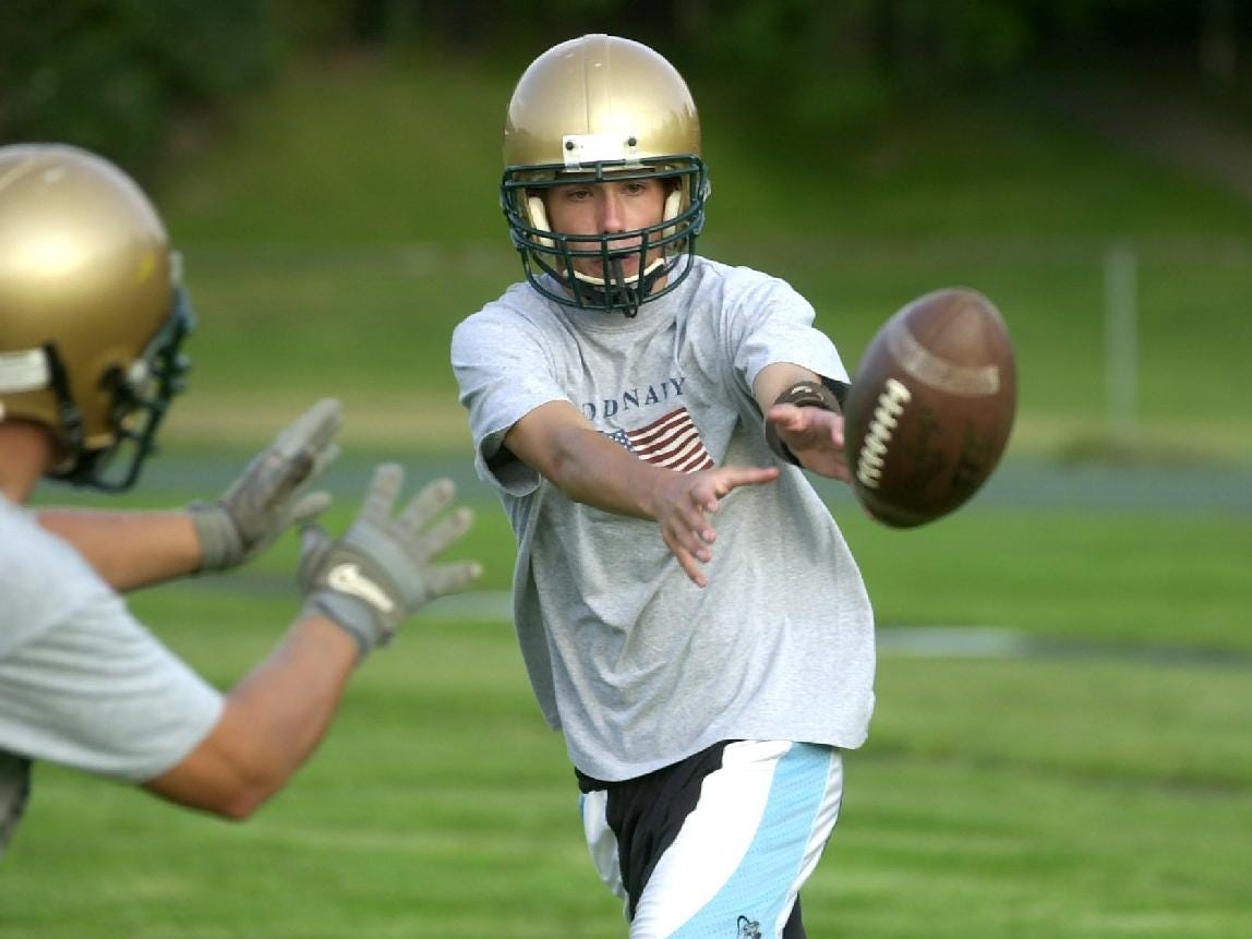 In 2001, Vestal's quarterback Joe Talbut pitches to fullback during practice.