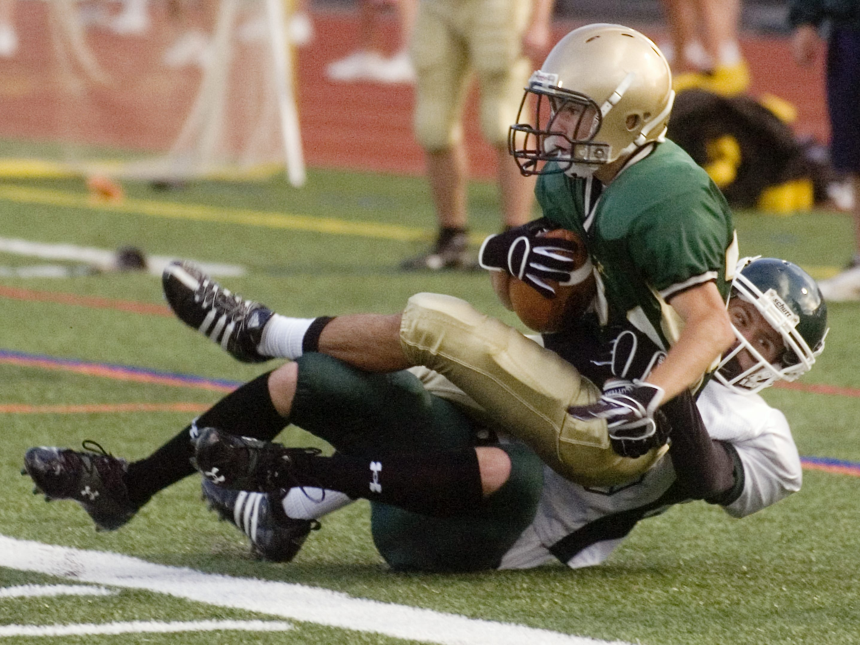 In 2008, Vestal's Tim Vieira, top, is taken down by Elmira South Side's Fred Nichols in the first quarter of the season-opener at Dick Hoover Stadium.