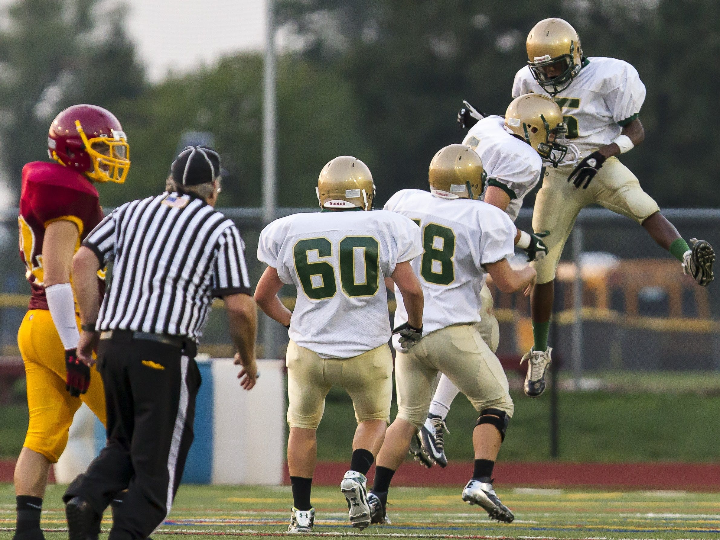 In 2012, Vestal's players celebrate a big play during the season opener at Ithaca against the Little Red.