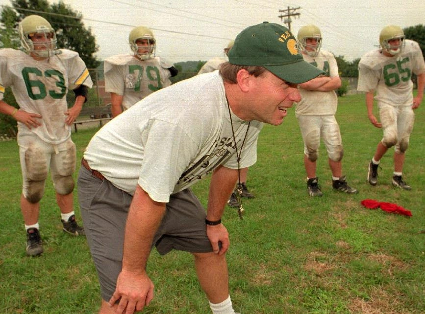 In 1997, Vestal football coach Dave Williams shouts at his players during a two-on-two blocking drill at a recent practice.