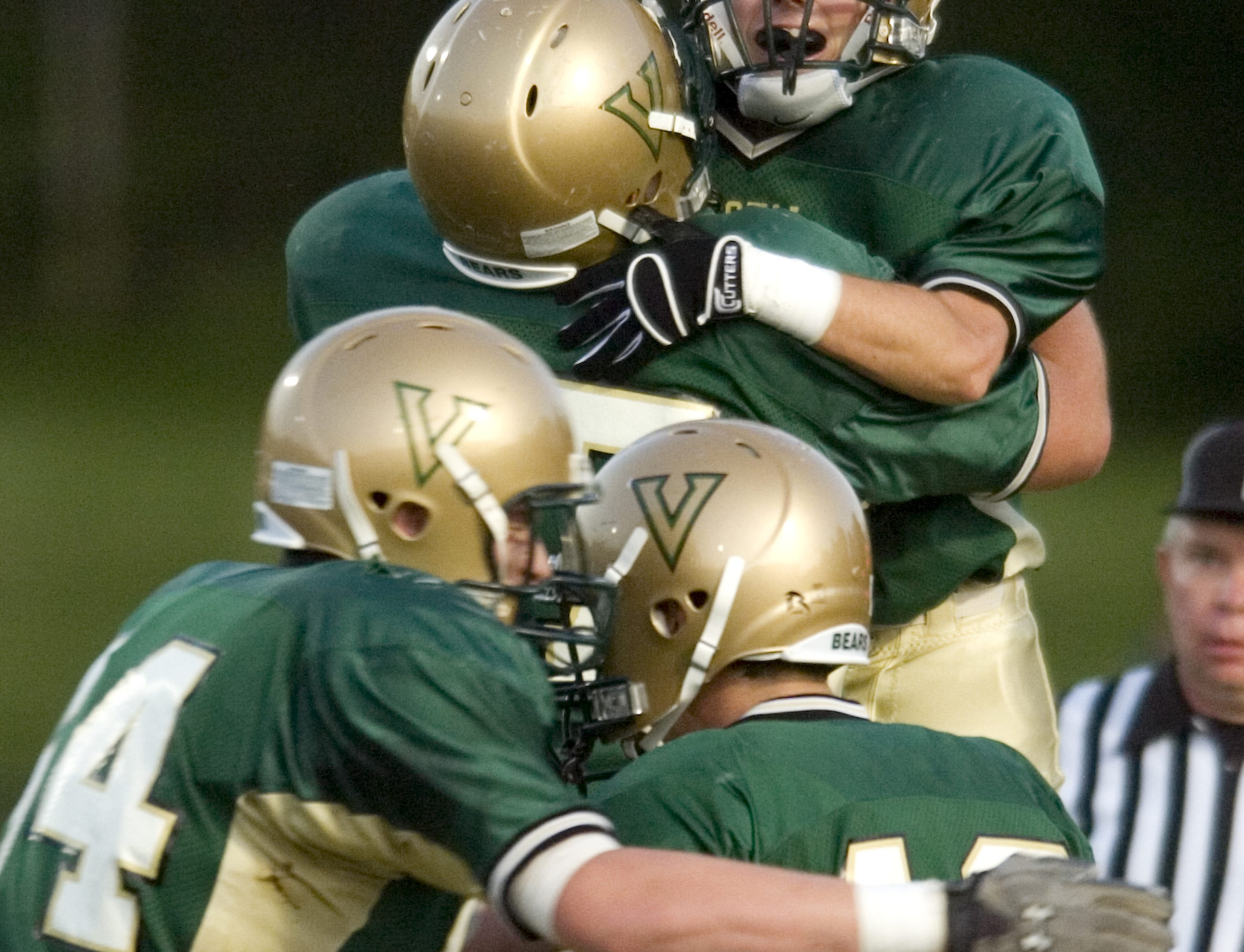 In 2009 Vestal's Nick Anderson, top right, is lifted up by Kyle Sherman as they and teammates Nick Keeler, bottom right, and Chris Bowe celebrate Anderson's touchdown reception in the first quarter of the game at Vestal's Dick Hoover Stadium.