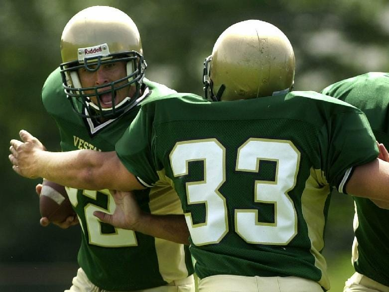 Vestal High School's Mark Peretore, left, Mike Paolucci, center, and Steve Campbell in 2003.
