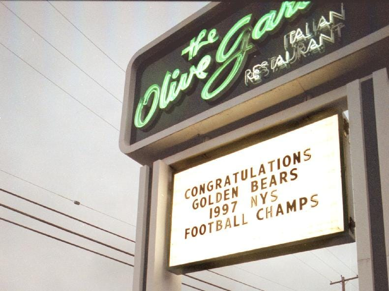 Signs like this one can be seen on the vestal parkway congratulating the Vestal football team on their win to become 1997 football champions.