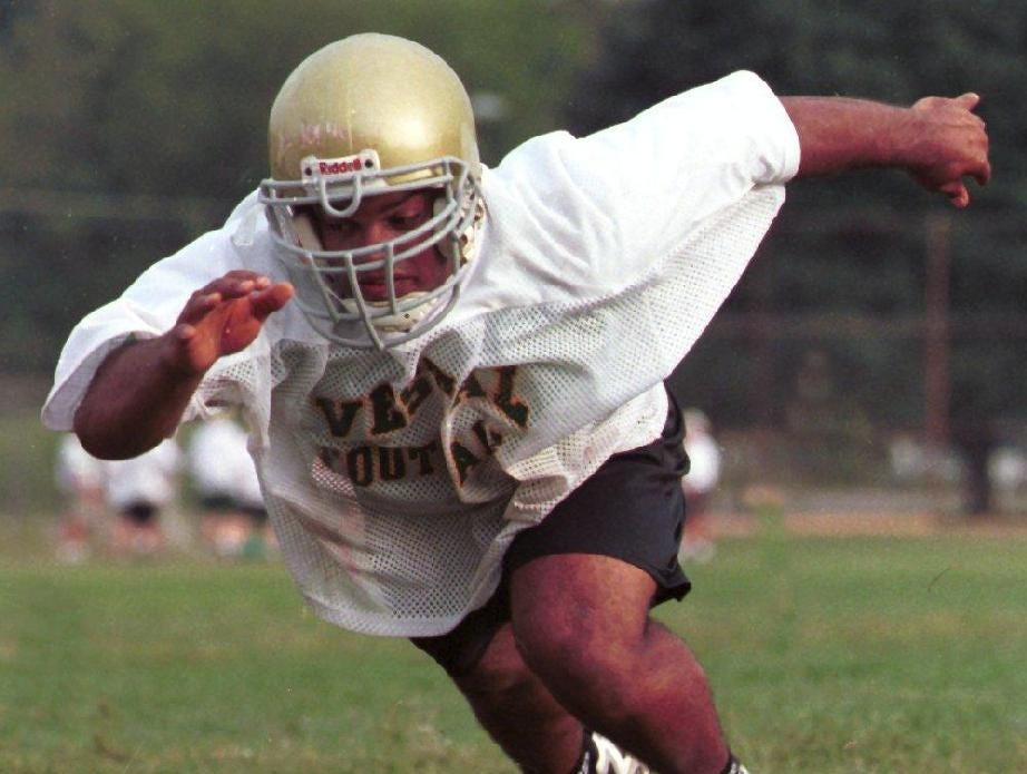 In 1998, Kurt Johnson of the Vestal varsity football team takes off from the line of scrimmage during a recent practice.