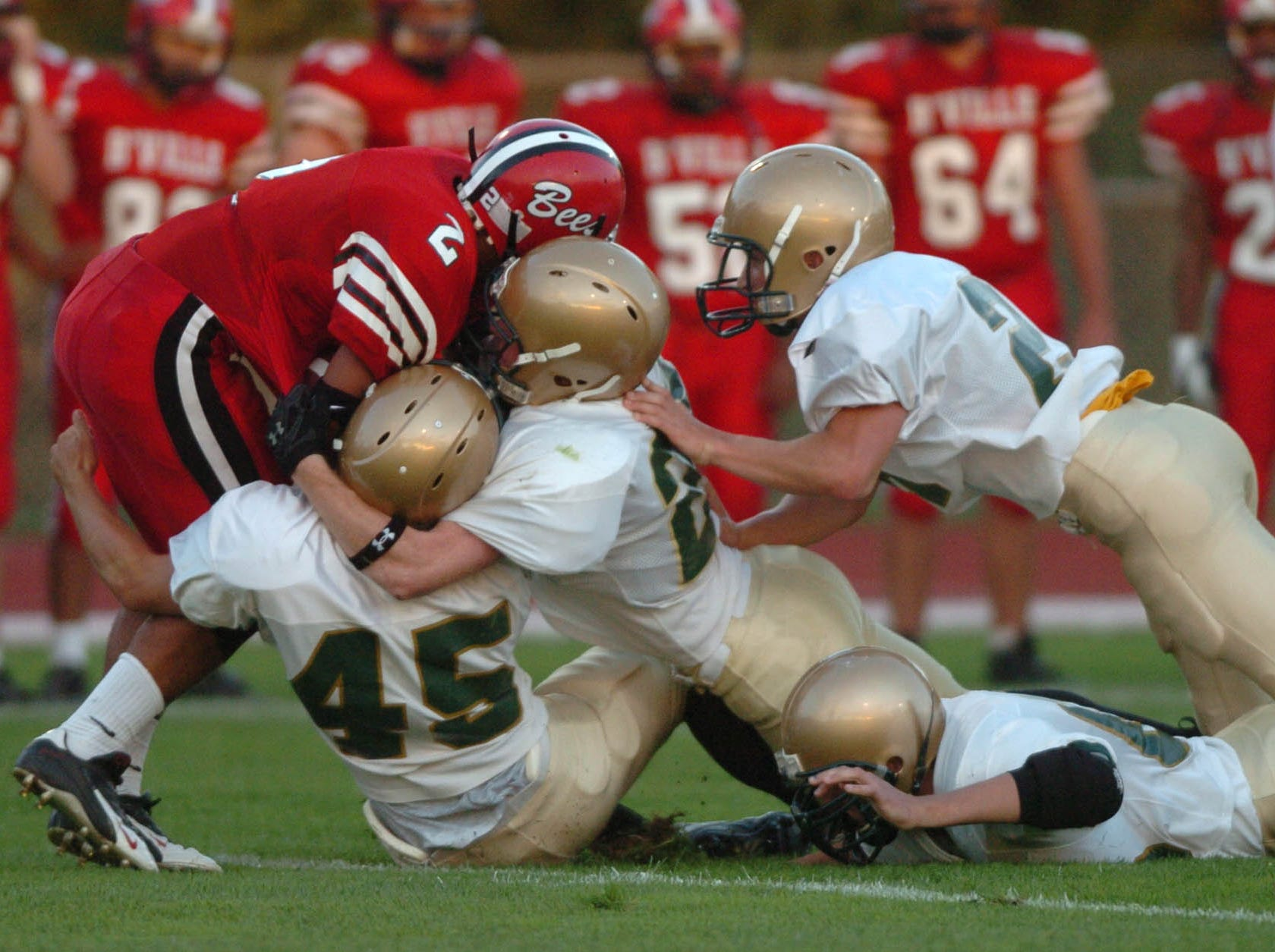 A host of Vestal defenders swarm Baldwinsville running back Chris Silva in the first quarter during Class AA football action on the opening on the 2005 season at Baldwinsville.