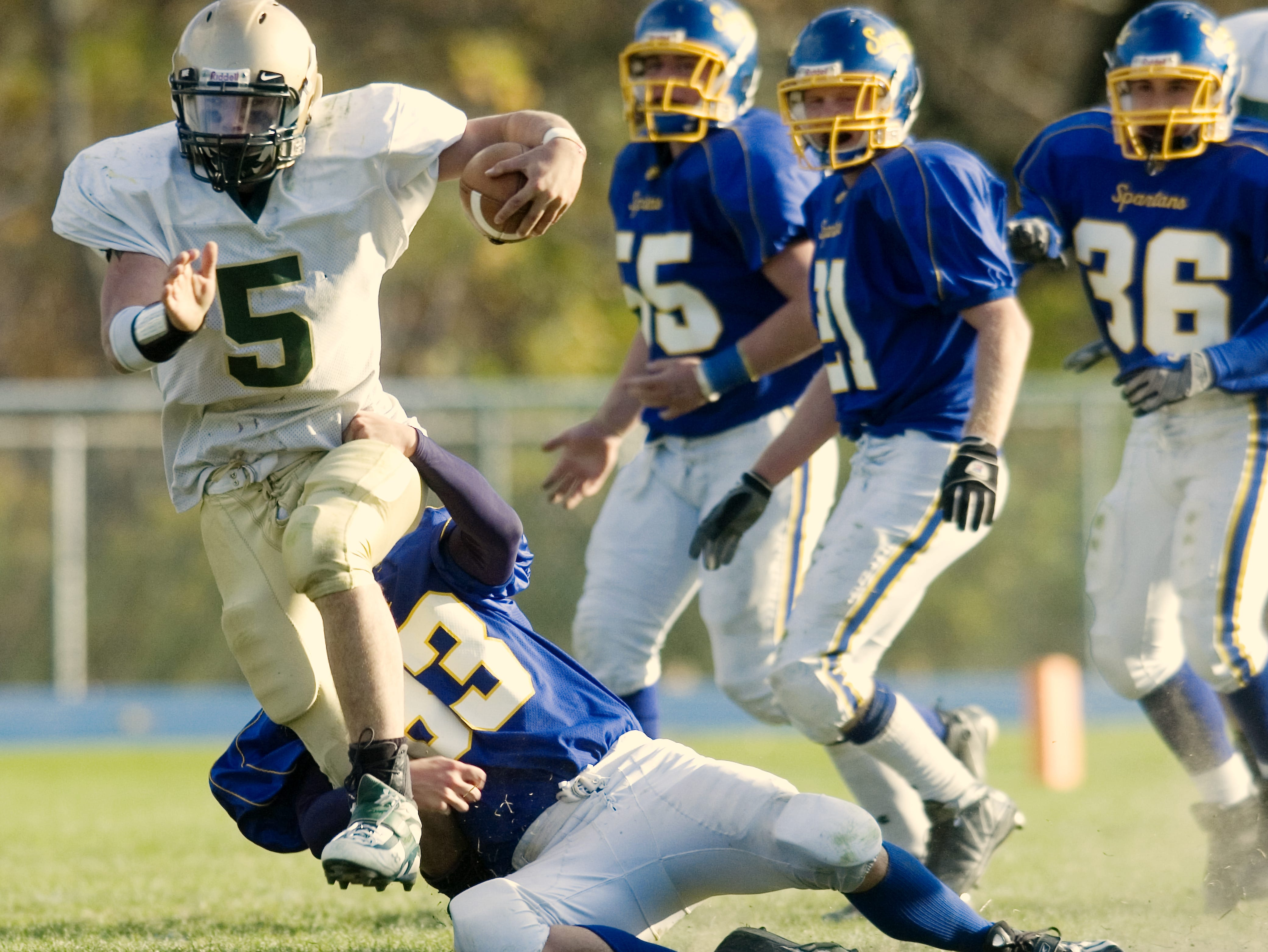 In 2008, Maine-Endwell's Adam Rosenbarker, bottom, tackles Vestal's Cody Scepaniak in the third quarter at M-E.
