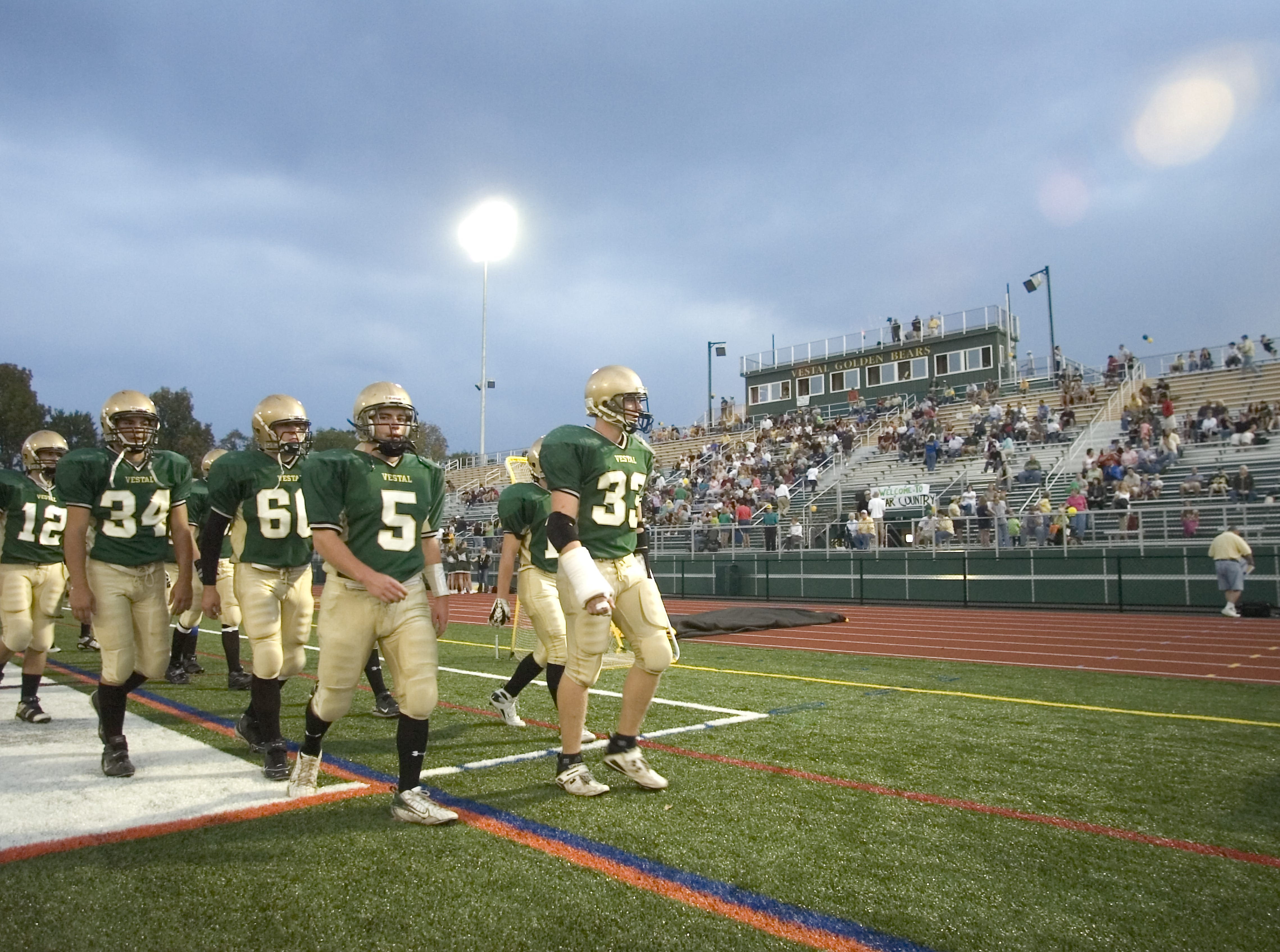 In 2007, Vestal High School football players head to the locker room prior to the start of the first home game of the season in the new stadium against Ithaca.