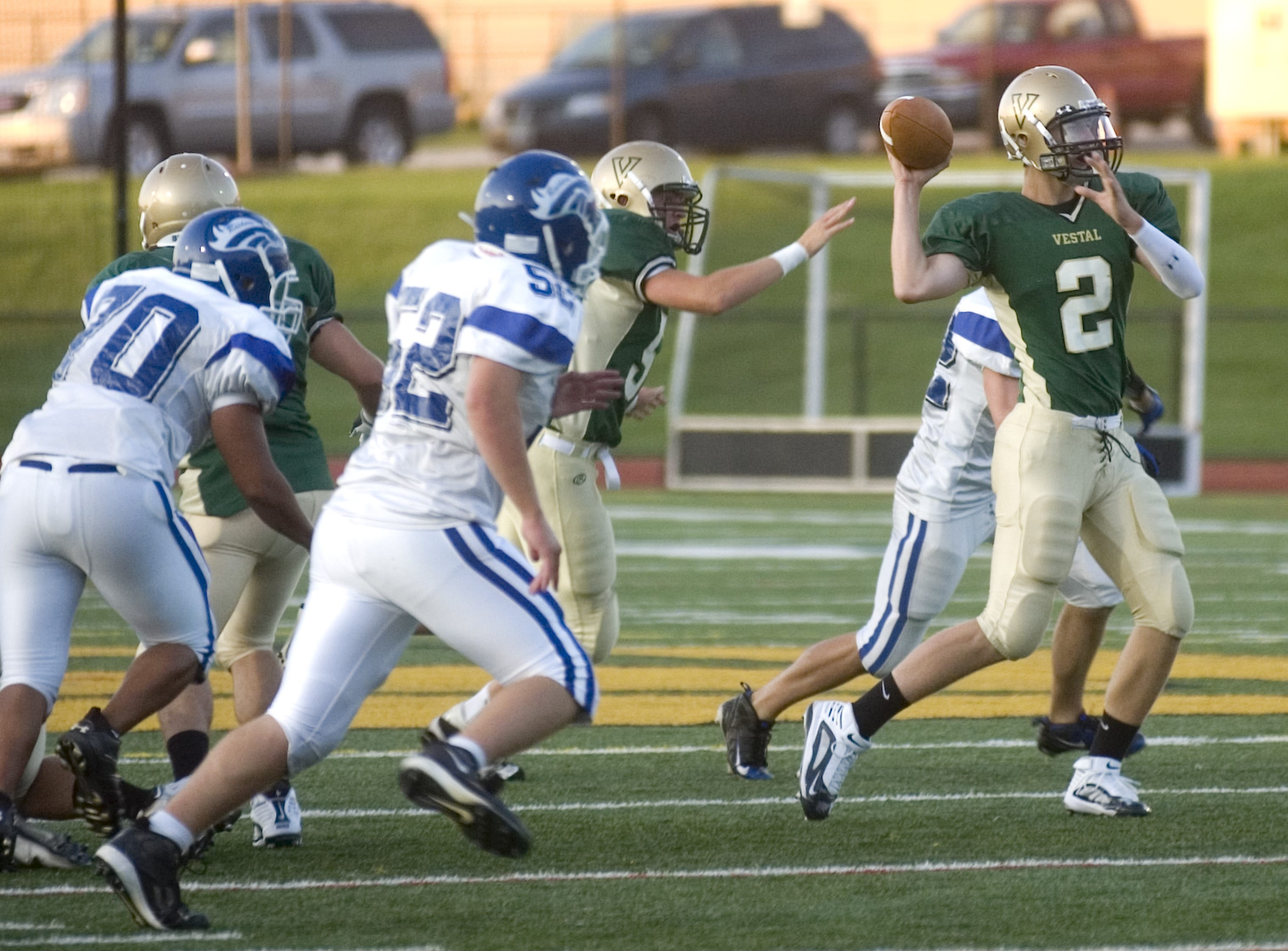 In 2009, Vestal quarterback Caleb Scepaniak, center, looks to pass at Vestal's Dick Hoover Stadium.