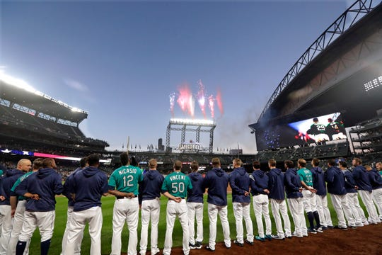 The Seattle Mariners line up during the playing of the national anthem on Sept. 28 at Safeco Field. The team's strong chemistry was often cited as a chief reason for its blazing start to the 2018 season. But the team's performance tailed off later in the summer, leading to questions about whether the clubhouse splintered.