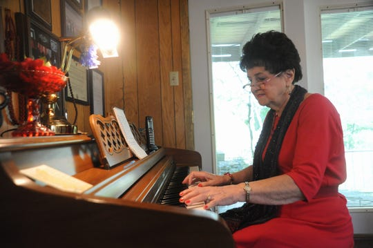 Ridgecrest native Carolyn Snypes plays the piano in the home she built with her husband of 70 years in her hometown.