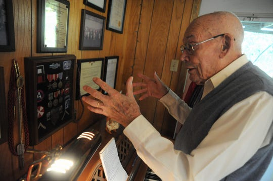 Earl Snypes talks about he various patches and medals he received for his service in World War II, in which he took part in three major conflicts.