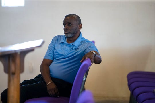 Pastor Adam Carrington hosts a meeting with residents and city council members and candidates to figure out the cityÕs water bill issues across Corpus Christi, and in the Hillcrest neighborhood, at Brooks AME Worship Center on Thursday, October 4, 2018. During the meeting he held up the bill of a person who had received a $4,000 water bill and chosen to cut off their service. City ordinance does not allow people to live in a home without running water.