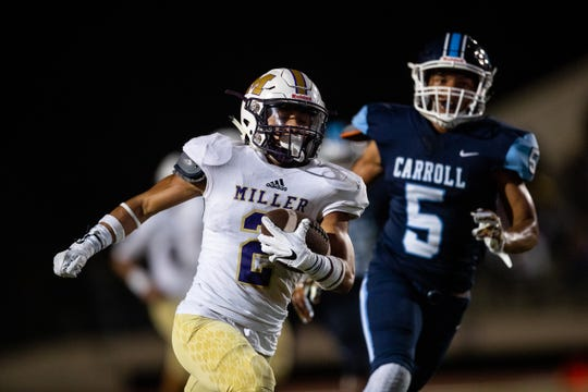 Miller's Ralph Rodriguez runs the ball for a touchdown during their game against Carrol at Buccaneer Stadium on Thursday, Oct. 4, 2018.
