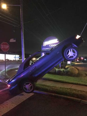 This car is not attached to a tow truck: It ended up suspended on a guy wire as a result of a DUI accident, according to the Berlin Police Department.