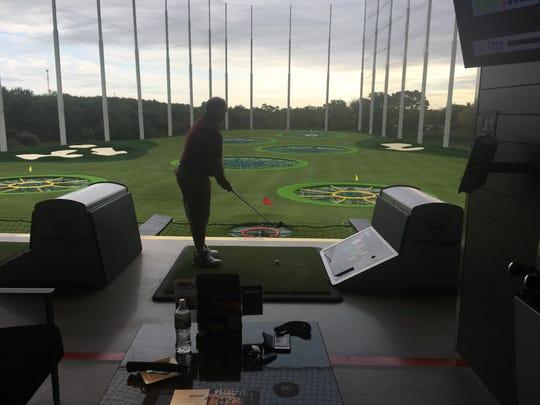 "Joe Pennock of Mount Laurel hits some golf balls on Topgolf Mount Laurel's opening day. He called the venue ""pretty impressive."""