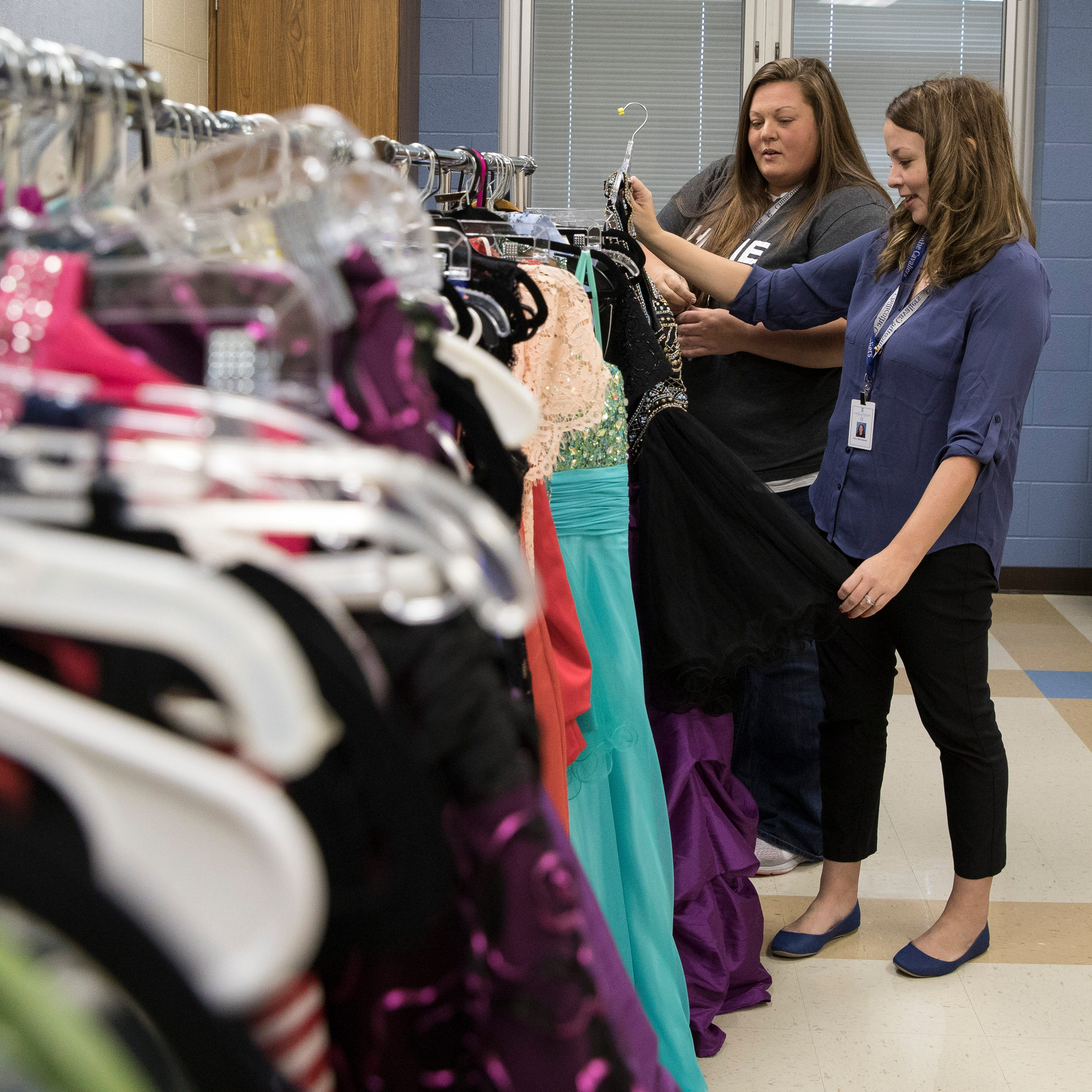 Tabitha Muse, left, and Sarah Hawthorne go through and accessorize some of the dresses that have been donated to Project GLAM! for Chillicothe's upcoming homecoming dance. The two have been hard at work collecting male and female clothes and other accessories to give to students who might not have the money for elaborate dance attire.